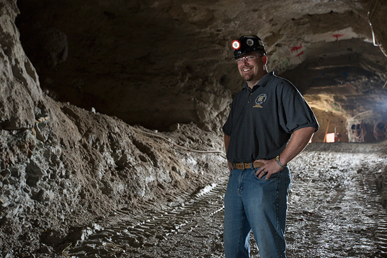 Braden Lusk standing in the experimental mine